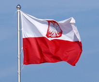 Poland charges lawyer with spying for Russia Polish flag with coat of arms. Olek Remesz. WikImedia Commons   ...