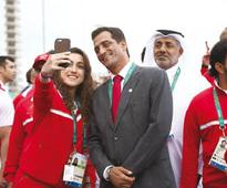 Qatar relishes moment to shine at opening cere... Qatar swimmer Nada Arakji takes a selfie with Qatar Swimming Federation Pres...