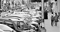 Scarce parking a major problem on Devaraj Urs Road