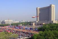 Kenya's Tuwei sets course record at Yellow River Estuary International Marathon