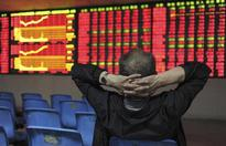 Shanghai stocks, Aussie dollar down after Moody's downgrades China