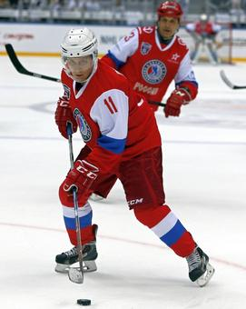 Putin hits the ice for a game of ice hockey
