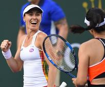 Hingis bids farewell with doubles defeat in Singapore