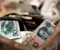 China says has no policy to devalue currency as Xi prepares to meet Trump