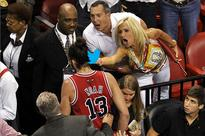 Bird-flipping Heat fan Filomena Tobias is sorry, sort of, for giving Joakim Noah the finger