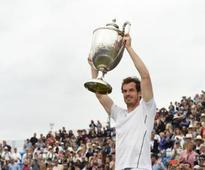 Andy Murray beats Milos Raonic to be crowned king of Queen's for a record fifth time