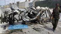 Twin suicide bombs claimed by al-Shabab kill 20 people in Somalia