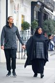 Pregnant Janet Jackson covers up belly on walk in London