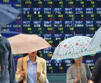 Nikkei takes cue from Wall Street records, logs weekly gain