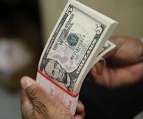 Trump rally pauses as stocks, dollar slip on profit-taking