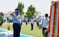 Air Chief BS Dhanoa leads a 4 aircraft MiG-21 'Missing Man' formation flypast to honour Kargil martyrs