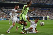 Lucas Vazquez hits Raheem Sterling with horror tackle - but Real Madrid star AVOIDS red card