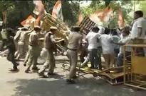 Congress workers protest outside BJP headquarters in Delhi