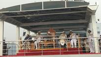 President reviews Indian Navy fleet off Vizag shore from INS Sumitra