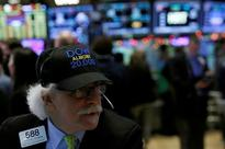 Wall Street falls as financials stumble, oil drops