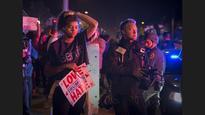 Protesters greet Donald Trump in Burlingame