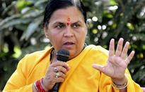 BJP Vice-President Uma Bharti dares Mulayam to withdraw support from UPA Government