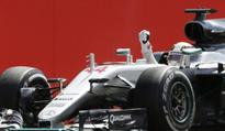 Three times lucky for Lewis