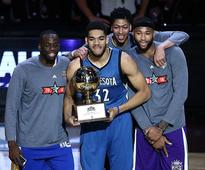 Karl-Anthony Towns of the Minnesota Timberwolves poses with the trophy and Draymond Green of the Golden State Warriors, Anthony Davis of the New Orleans Pelicans and DeMarcus Cousins of the Sacramento Kings after winning in the Taco Bell Skills Challenge