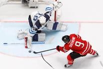 Ice hockey-Finland stun Canada, Czechs pip Swiss at worlds
