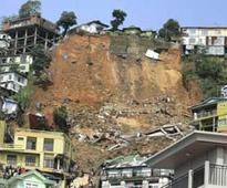 Landslide toll at 13, more bodies left