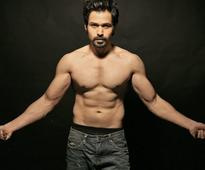 Who is Emraan`s workout buddy?