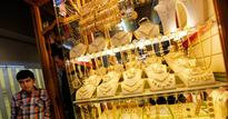 Gold prices up on scattered buying, silver ends lower