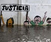 In Paraguay, more flee worst floods in decades as levee creaks