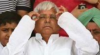 In talks with SP, Congress for tie-up for UP polls: Lalu Prasad Yadav
