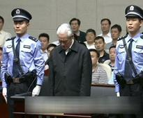 China jails associate of former security chief for life for graft
