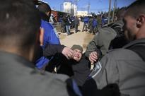 Israeli police push to evict illegal settlers from synagogue