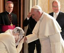 Privilege of the white: Princess Charlene wears white dress and mantilla to meet Pope Francis