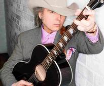 Hear Dwight Yoakam Take A Bluegrass Turn With 'These Arms'