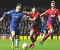 Spurs survive Inter scare as Torres saves Chelsea