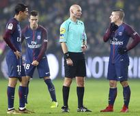 French referee suspended for kicking player during match