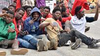 Hundreds of African refugees storm Spain's killer fence