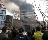 Blaze topples Tehran's iconic Plasco building, 30 fire fighters killed