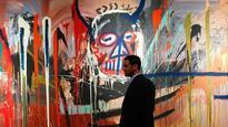 Portrait by US artist Jean-Michel Basquiat scores record $77.9 million
