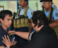 Indonesian sailor says pirates were about to behead him when he swam out to sea in flight