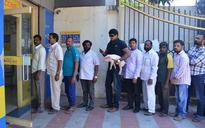 Telugu actor Ravi Babu spotted with piglet at an ATM in Hyderabad