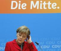 Merkels conservatives and Greens to start coalition talks in western state