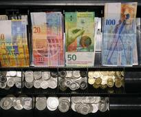 Brexit worries spur safe-haven flows into Swiss franc, Danish crown