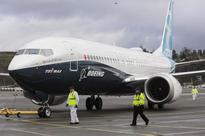 Boeing posts 2nd-quarter loss, cushioned by defense profit