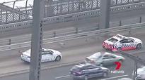 Man climbs Harbour Bridge pylon, causes traffic chaos